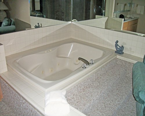 A bathroom with shower and bathtub.