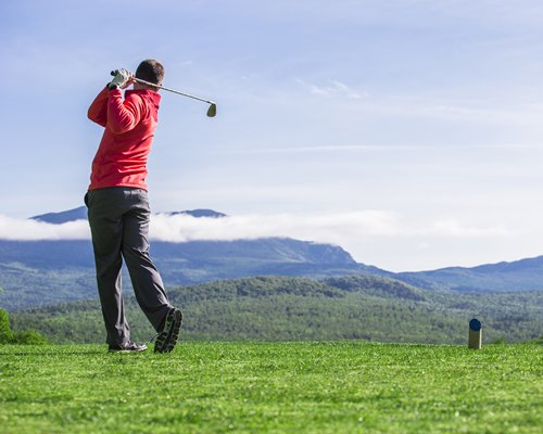 A golfer playing golf at the golf course.