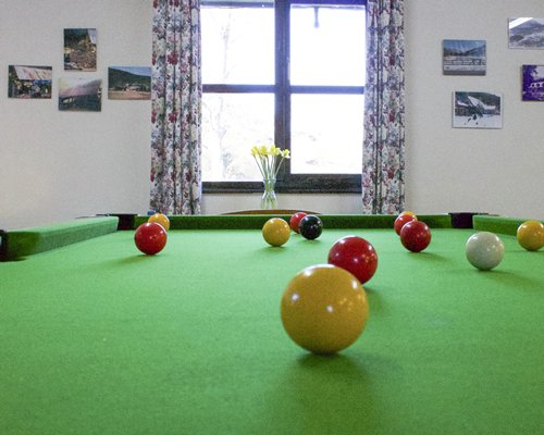 An indoor recreational room with pool table.