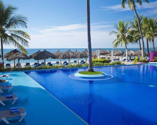 Golden Shores & Crown Paradise Club alongside the beach.