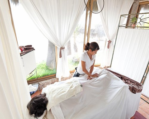 A woman enjoying massage at the spa.