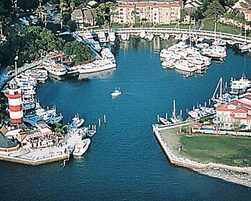 An aerial view of Harbour Club At Harbour Town with boats and landscaping.
