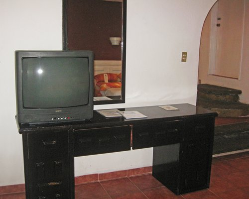 Furnished room with a television.