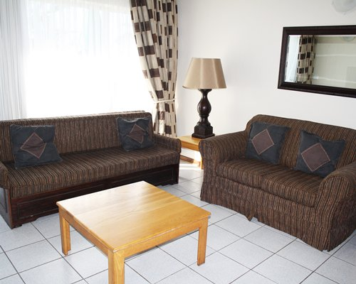 A well furnished living room with sofas.