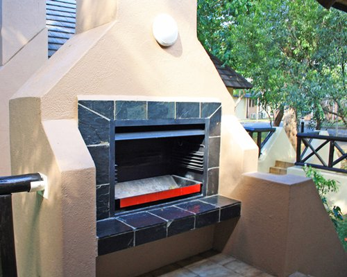 Outdoor picnic area with fireplace.