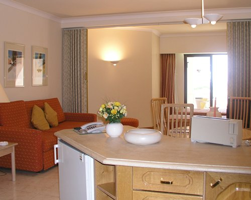 A well furnished open plan living and dining area with an outside view.