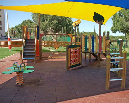 Scenic outdoor kids playground with sunshades.