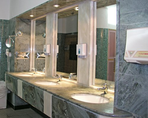 A bathroom with multi sink vanity.