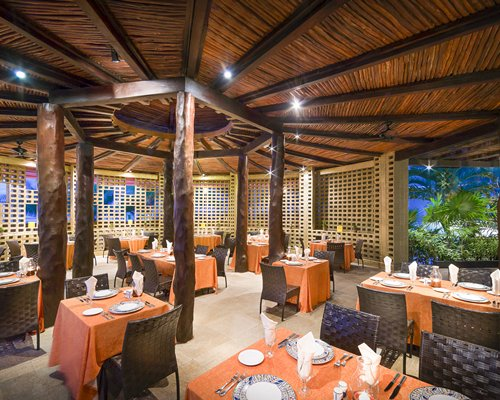 A well furnished indoor restaurant with an outside view.