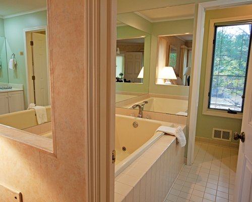 A bathroom with a bathtub.