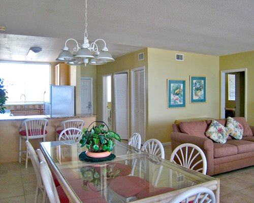 An open plan living and dining area alongside the kitchen with a breakfast bar.