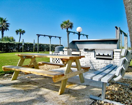 An outdoor picnic area and barbecue grill.