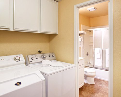 Laundry area alongside a bathroom.