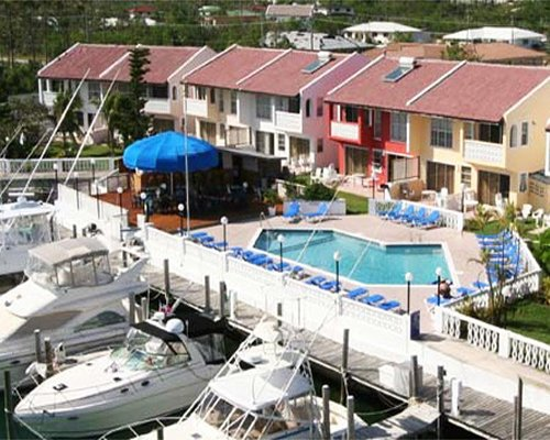 A marina alongside the resort unit with swimming pool.