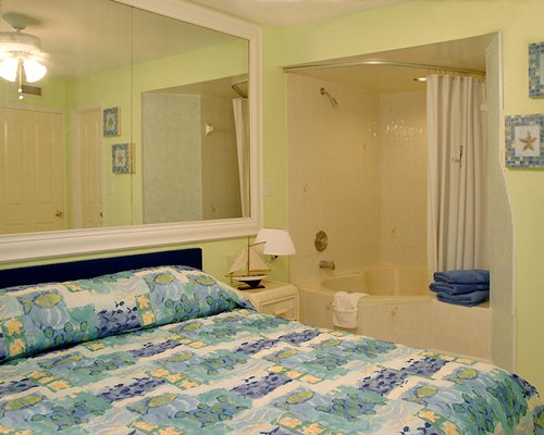 A well furnished bedroom with a mirror and bathtub.