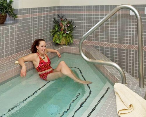 A woman enjoying in a mini indoor swimming pool.