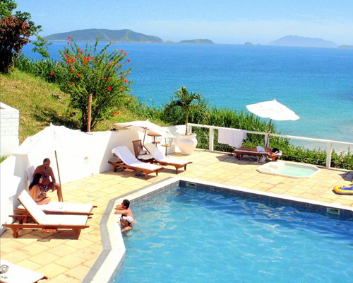 Outdoor swimming pool overlooking the ocean.