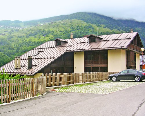 Exterior view of a unit with parking lot surrounded by mountains.