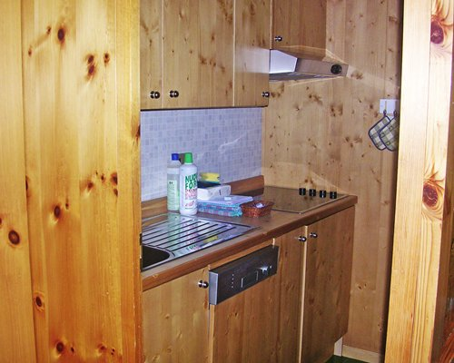 A wooden themed well equipped kitchen.