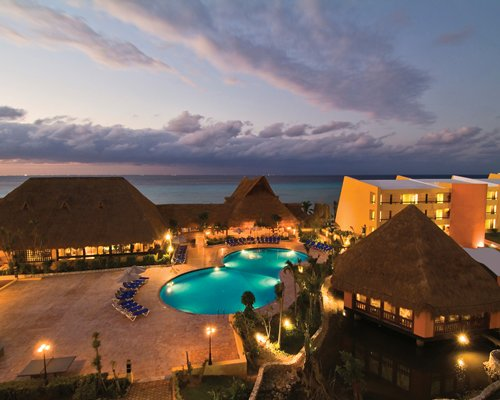 A night view of the MVC at Melia Cozumel resort and surroundings alongside the ocean.