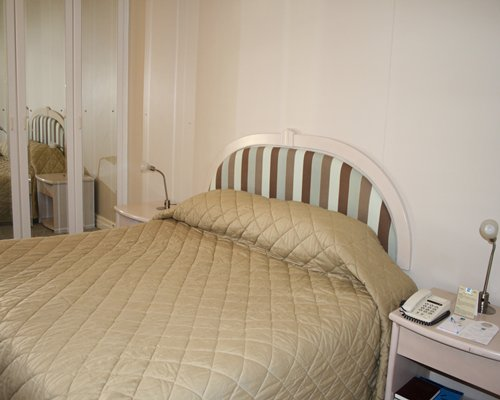 A well furnished bedroom with a telephone.