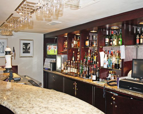 Indoor bar with bar counter.