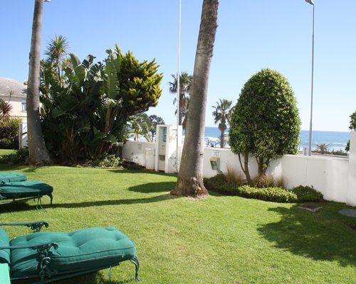 Outdoor picnic area with chaise lounge chairs and ocean view.