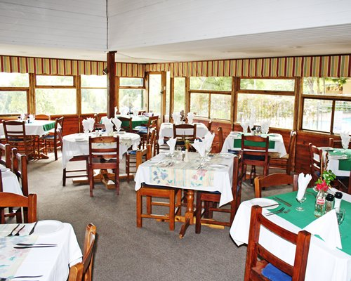 An indoor fine dining restaurant area of the Knysna Chalets resort.