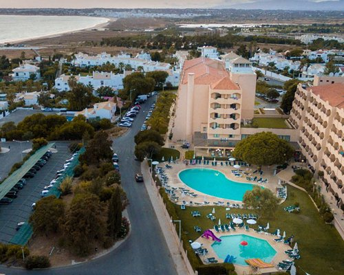 An aerial view of the resort property with a swimming pool.
