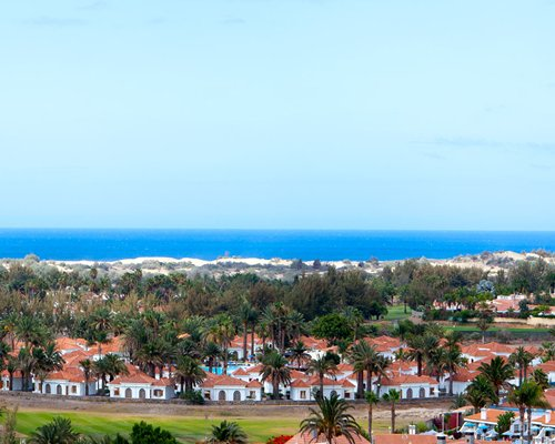 A view of the resort property alongside the ocean.