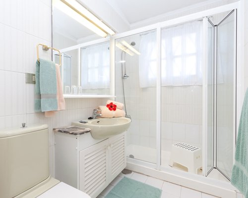 A bathroom with a shower stall and closed sink vanity.