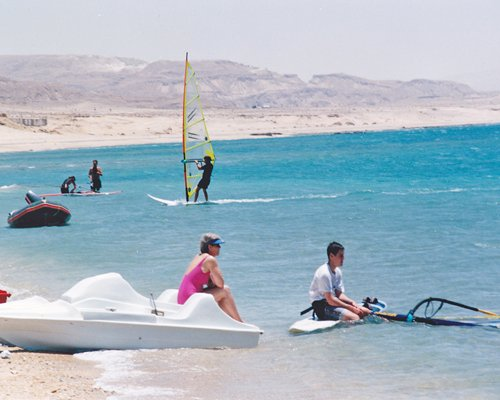 View of people windsurfing.