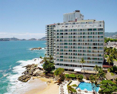 An exterior view of the resort properties alongside the beach.