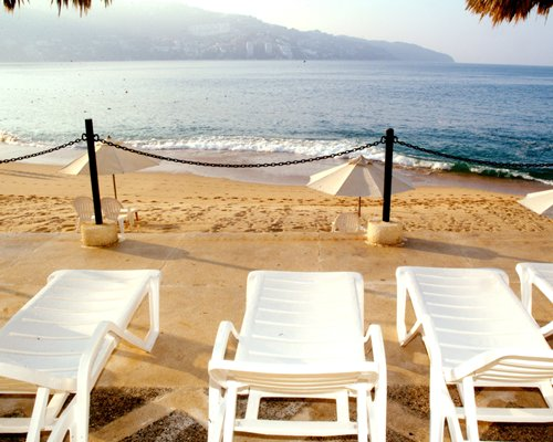 Chaise lounge chairs on the beach.
