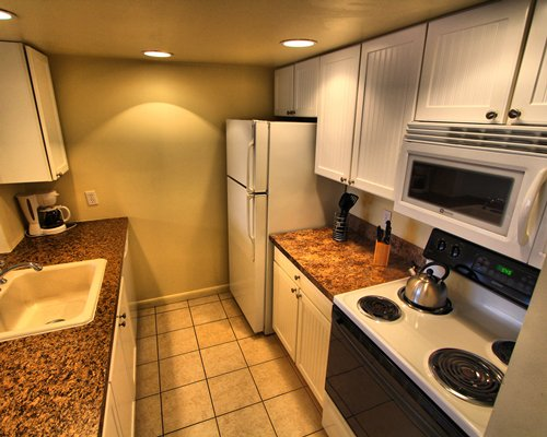 An open plan dining and kitchen area with breakfast bar.
