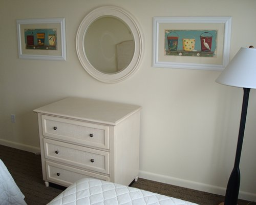 A well furnished bedroom with mirror.