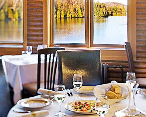 View of food on the table at an indoor restaurant with lake view.