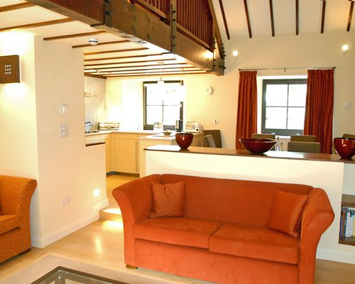 A well furnished living area alongside the kitchen and dining.