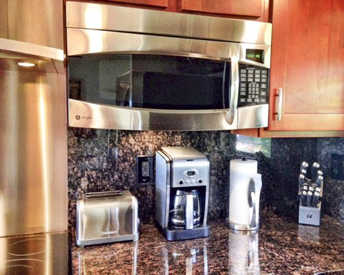 A view of kitchen accessories alongside a microwave oven.