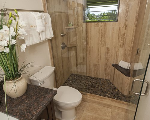 A bathroom with a standing shower.