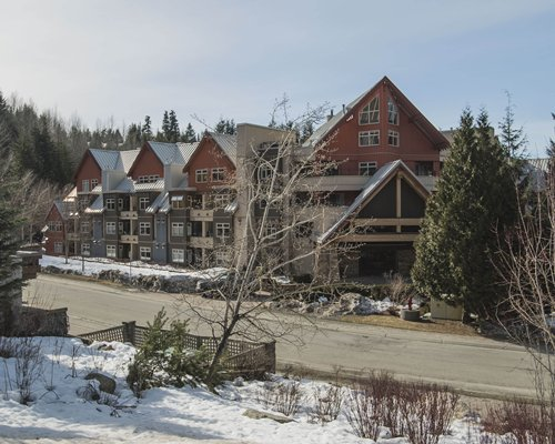 Scenic exterior view of Whistler Vacation Club At Lake Placid Lodge covered by snow.