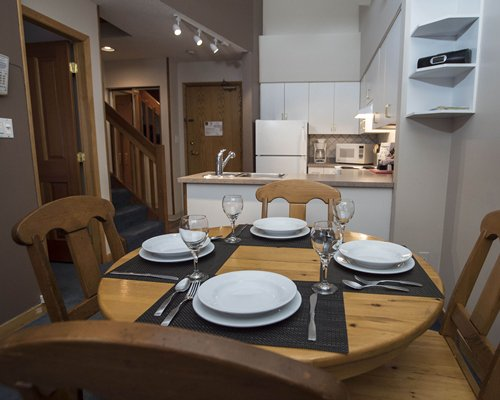 An open plan kitchen with dining area alongside staircase.