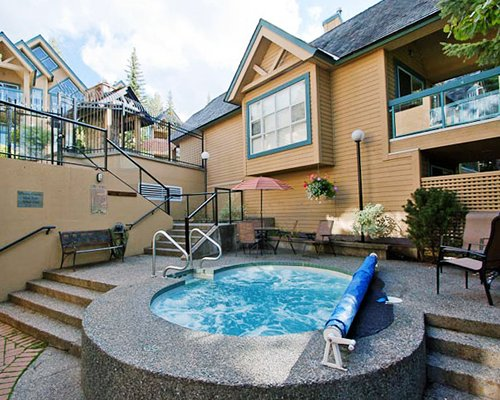 An outdoor hot tub alongside the resort units.