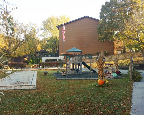 An outdoor playscape alongside resort unit.