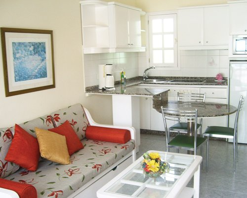 An open plan living dining and kitchen area.