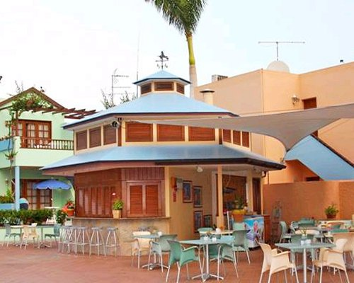 An outdoor restaurant with patio alongside the resort units.