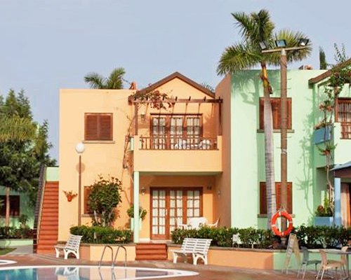 An exterior view of the swimming pool with patio alongside resort unit.