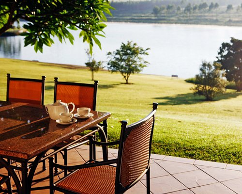 A well furnished restaurant area and lake view.