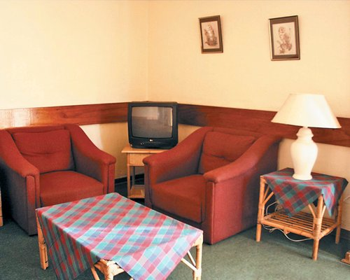 A well furnished living room with a television.