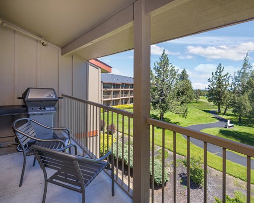 Balcony with patio furniture and barbecue grill at WorldMark Eagle Crest.